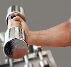 Man Lifting Dumbbell at Gym