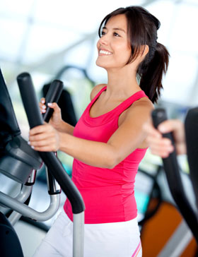 woman exercises on elliptical trainer