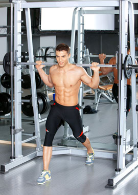 man with power rack smith machine
