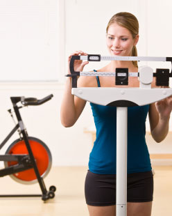 woman spin bike and scale